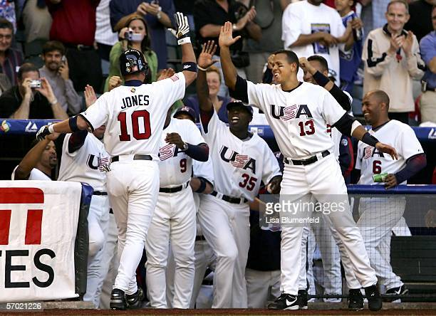 Chipper Jones of Team USA is congratulated by teammates Dontrelle Willis and Alex Rodriguez after hitting a solo home run against Team Mexico during...