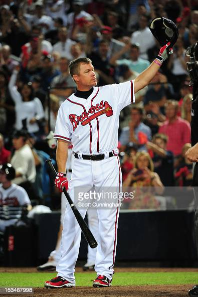 Chipper Jones of the Atlanta Braves acknowledges the crowd before his last atbat against the St Louis Cardinals during the National League Wild Card...