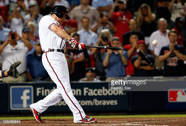 Chipper Jones of the Atlanta Braves breaks his bat as he hits an infield single to extend the game in the ninth inning against the St Louis Cardinals...