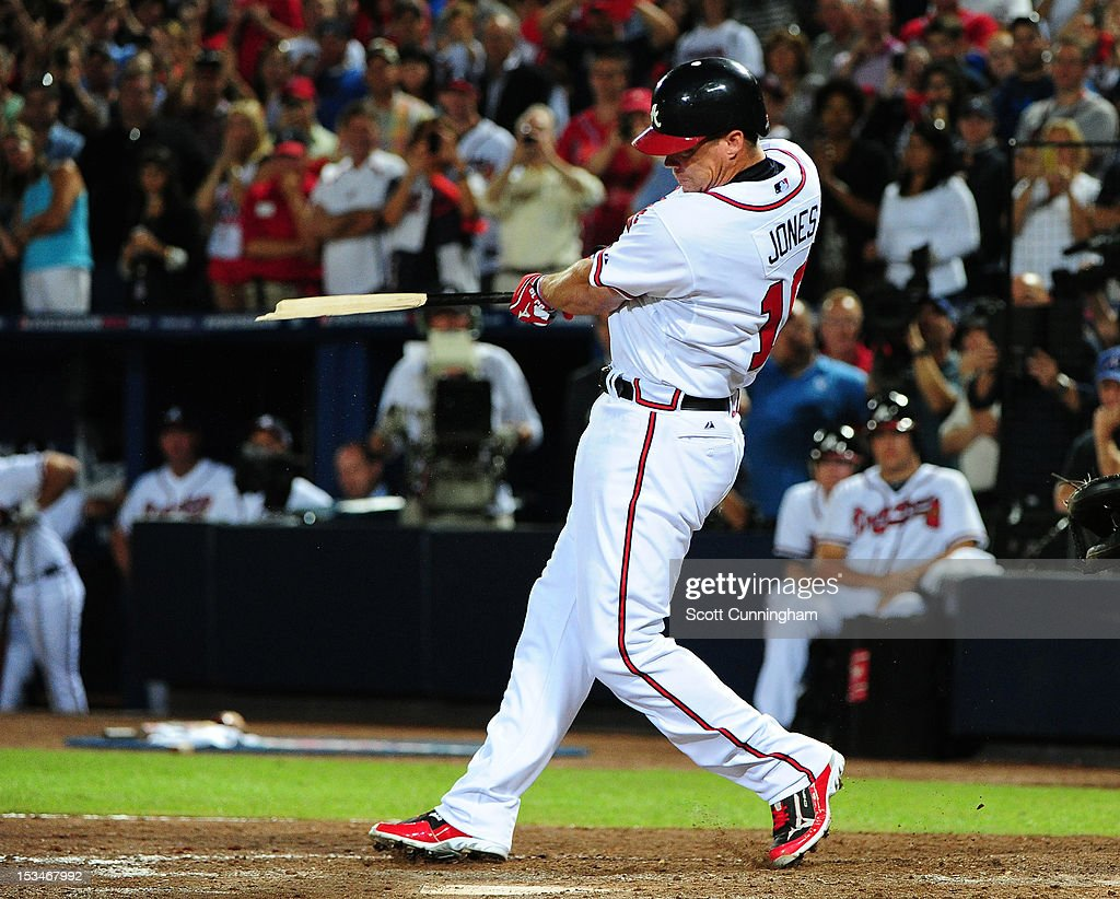<a gi-track='captionPersonalityLinkClicked' href=/galleries/search?phrase=Chipper+Jones&family=editorial&specificpeople=171256 ng-click='$event.stopPropagation()'>Chipper Jones</a> #10 of the Atlanta Braves breaks his bat hitting for a single in his last career at bat against the St. Louis Cardinals during the National League Wild Card Game at Turner Field on October 5, 2012 in Atlanta, Georgia.