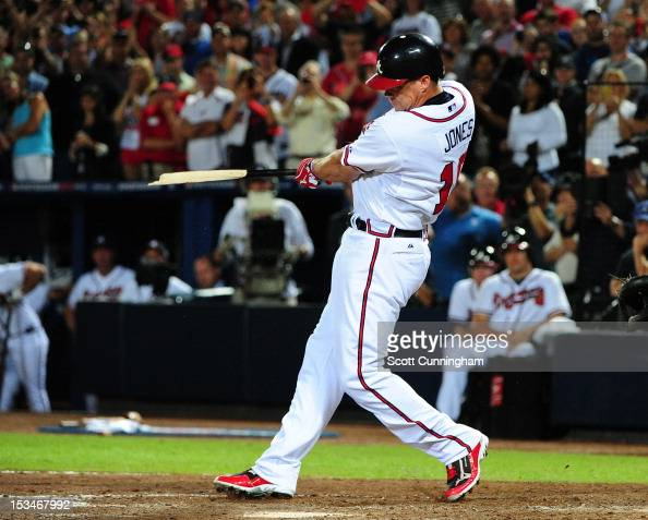 Chipper Jones of the Atlanta Braves breaks his bat hitting for a single in his last career at bat against the St Louis Cardinals during the National...