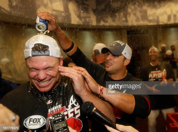 Chipper Jones of the Atlanta Braves celebrates with Martin Prado after the game against the Miami Marlins at Turner Field on September 25 2012 in...