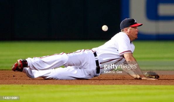 Chipper Jones of the Atlanta Braves dives for a ground ball by Daniel Murphy of the New York Mets in the sixth inning at Turner Field on April 17...