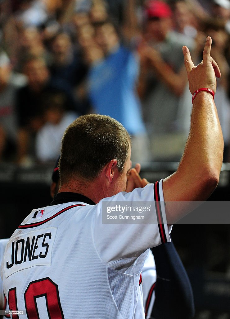 <a gi-track='captionPersonalityLinkClicked' href=/galleries/search?phrase=Chipper+Jones&family=editorial&specificpeople=171256 ng-click='$event.stopPropagation()'>Chipper Jones</a> #10 of the Atlanta Braves heads off the field after hitting a 11th inning walk off home run against the Philadelphia Phillies at Turner Field on May 2, 2012 in Atlanta, Georgia.