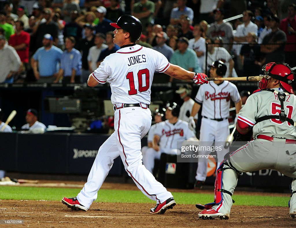 <a gi-track='captionPersonalityLinkClicked' href=/galleries/search?phrase=Chipper+Jones&family=editorial&specificpeople=171256 ng-click='$event.stopPropagation()'>Chipper Jones</a> #10 of the Atlanta Braves hits a 11th inning walk off home run against the Philadelphia Phillies at Turner Field on May 2, 2012 in Atlanta, Georgia.