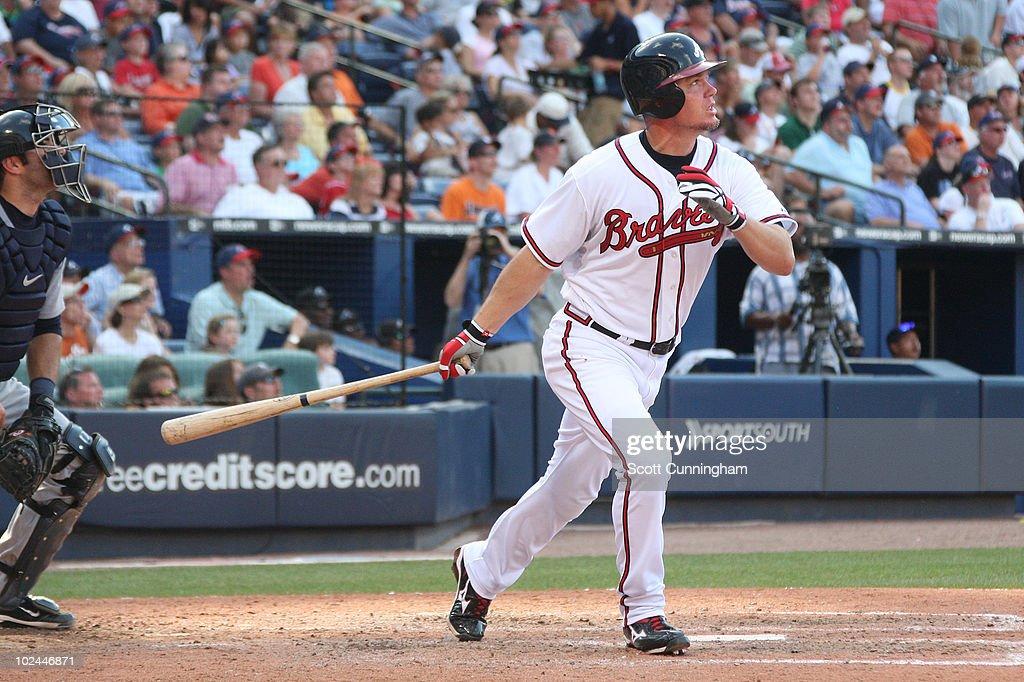 Chipper Jones of the Atlanta Braves hits a threerun home run against the Detroit Tigers at Turner Field on June 26 2010 in Atlanta Georgia The Braves...