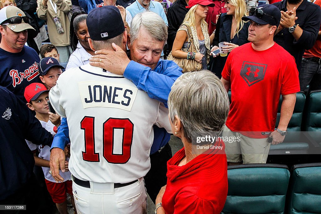 Chipper Jones #10 of the Atlanta Braves hugs his father after the game against the New York Mets at Turner Field on September 30, 2012 in Atlanta, Georgia. The Braves won 6-2.