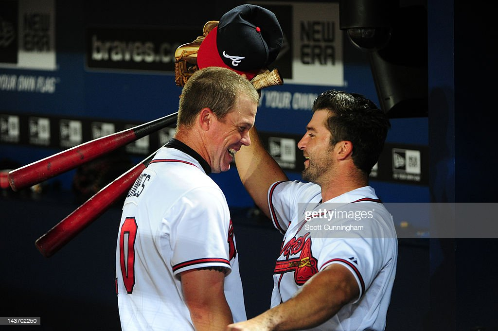 <a gi-track='captionPersonalityLinkClicked' href=/galleries/search?phrase=Chipper+Jones&family=editorial&specificpeople=171256 ng-click='$event.stopPropagation()'>Chipper Jones</a> #10 of the Atlanta Braves is congratulated by <a gi-track='captionPersonalityLinkClicked' href=/galleries/search?phrase=Dan+Uggla&family=editorial&specificpeople=542208 ng-click='$event.stopPropagation()'>Dan Uggla</a> #26 after hitting a 11th inning walk off home run against the Philadelphia Phillies at Turner Field on May 2, 2012 in Atlanta, Georgia.