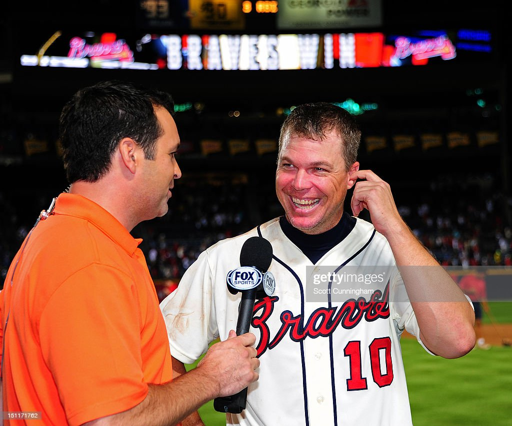 <a gi-track='captionPersonalityLinkClicked' href=/galleries/search?phrase=Chipper+Jones&family=editorial&specificpeople=171256 ng-click='$event.stopPropagation()'>Chipper Jones</a> #10 of the Atlanta Braves is interviewed after hitting a three-run walk-off home run against the Philadelphia Phillies at Turner Field on September 2 2012 in Atlanta, Georgia.