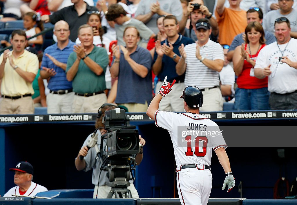 <a gi-track='captionPersonalityLinkClicked' href=/galleries/search?phrase=Chipper+Jones&family=editorial&specificpeople=171256 ng-click='$event.stopPropagation()'>Chipper Jones</a> #10 of the Atlanta Braves reacts after hitting a solo homer in the third inning against the Milwaukee Brewers at Turner Field on July 15, 2010 in Atlanta, Georgia.