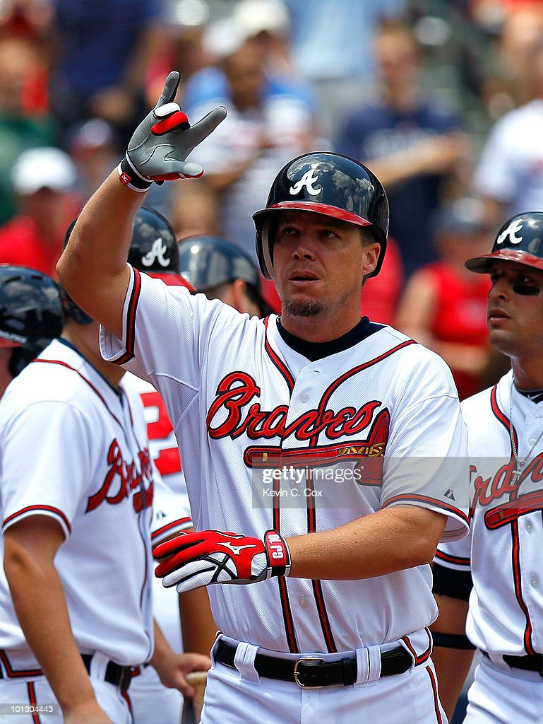 Chipper Jones #10 of the Atlanta Braves reacts after hitting a two-run homer in the first inning against the Philadelphia Phillies at Turner Field on May 31, 2010 in Atlanta, Georgia.
