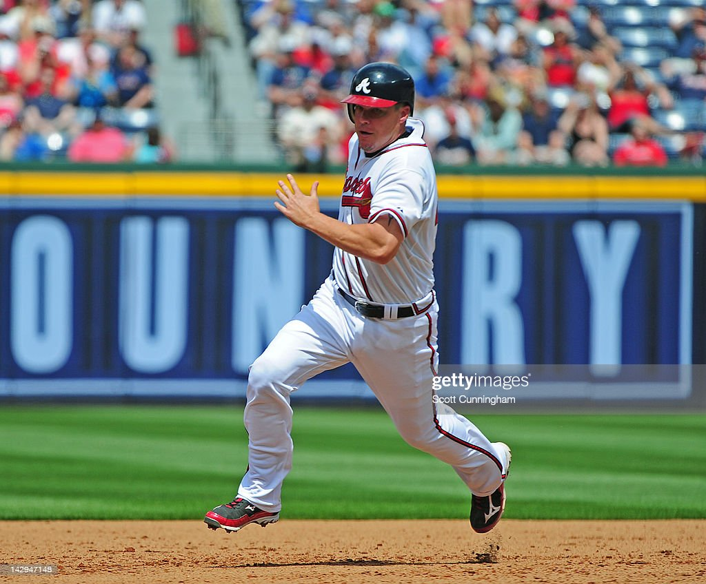 <a gi-track='captionPersonalityLinkClicked' href=/galleries/search?phrase=Chipper+Jones&family=editorial&specificpeople=171256 ng-click='$event.stopPropagation()'>Chipper Jones</a> of the Atlanta Braves rounds second base against the Milwaukee Brewers at Turner Field on April 15, 2012 in Atlanta, Georgia. All uniformed team members are wearing jersey number 42 in honor of Jackie Robinson Day.