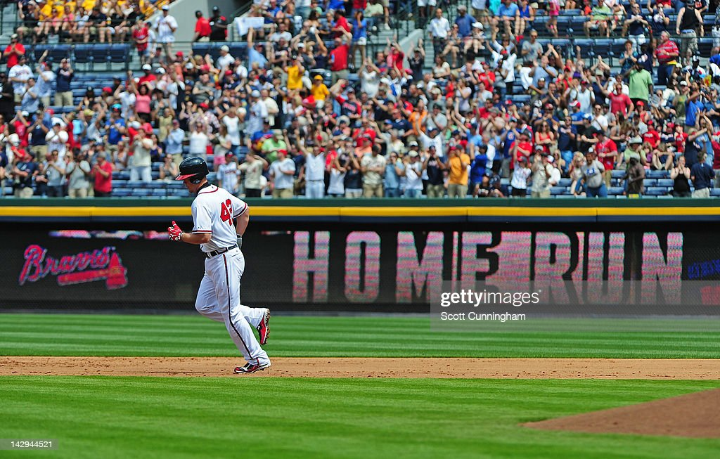 Chipper Jones of the Atlanta Braves rounds the bases after hitting a third inning home run against the Milwaukee Brewers at Turner Field on April 15, 2012 in Atlanta, Georgia. All uniformed team members are wearing jersey number 42 in honor of Jackie Robinson Day.