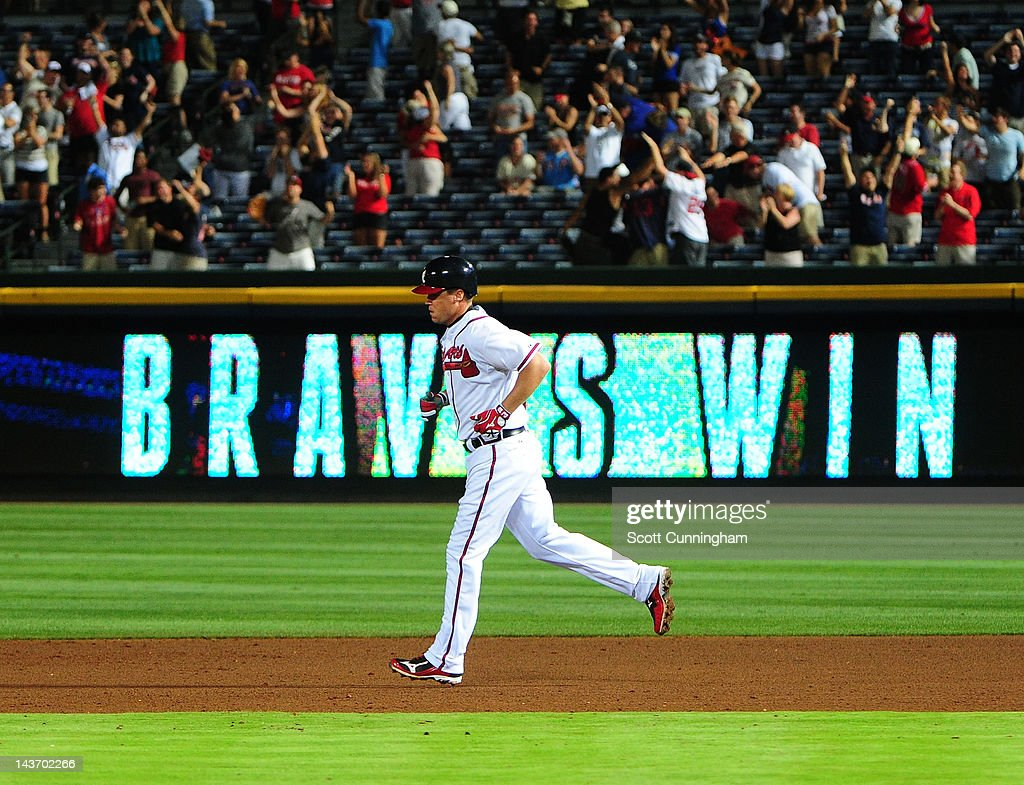 <a gi-track='captionPersonalityLinkClicked' href=/galleries/search?phrase=Chipper+Jones&family=editorial&specificpeople=171256 ng-click='$event.stopPropagation()'>Chipper Jones</a> #10 of the Atlanta Braves rounds the bases after hitting a 11th inning walk off home run against the Philadelphia Phillies at Turner Field on May 2, 2012 in Atlanta, Georgia.