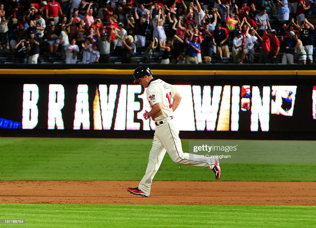 <a gi-track='captionPersonalityLinkClicked' href=/galleries/search?phrase=Chipper+Jones&family=editorial&specificpeople=171256 ng-click='$event.stopPropagation()'>Chipper Jones</a> #10 of the Atlanta Braves rounds the bases after hitting a three-run walk-off home run against the Philadelphia Phillies at Turner Field on September 2 2012 in Atlanta, Georgia.