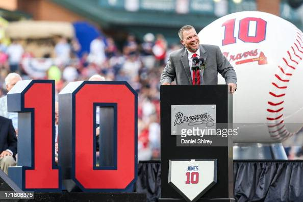Chipper Jones of the Atlanta Braves speaks to fans during his number retirement ceremony before the game against the Arizona Diamondbacks at Turner...