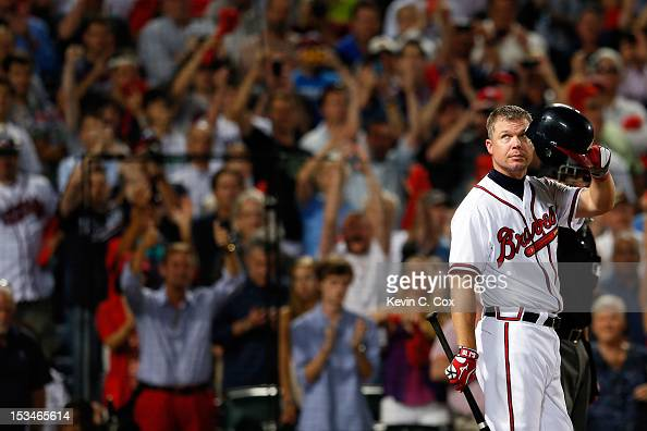 Chipper Jones of the Atlanta Braves tips his helmet to the crowd before his final at bat before the Braves lose to the St Louis Cardinals 63 during...