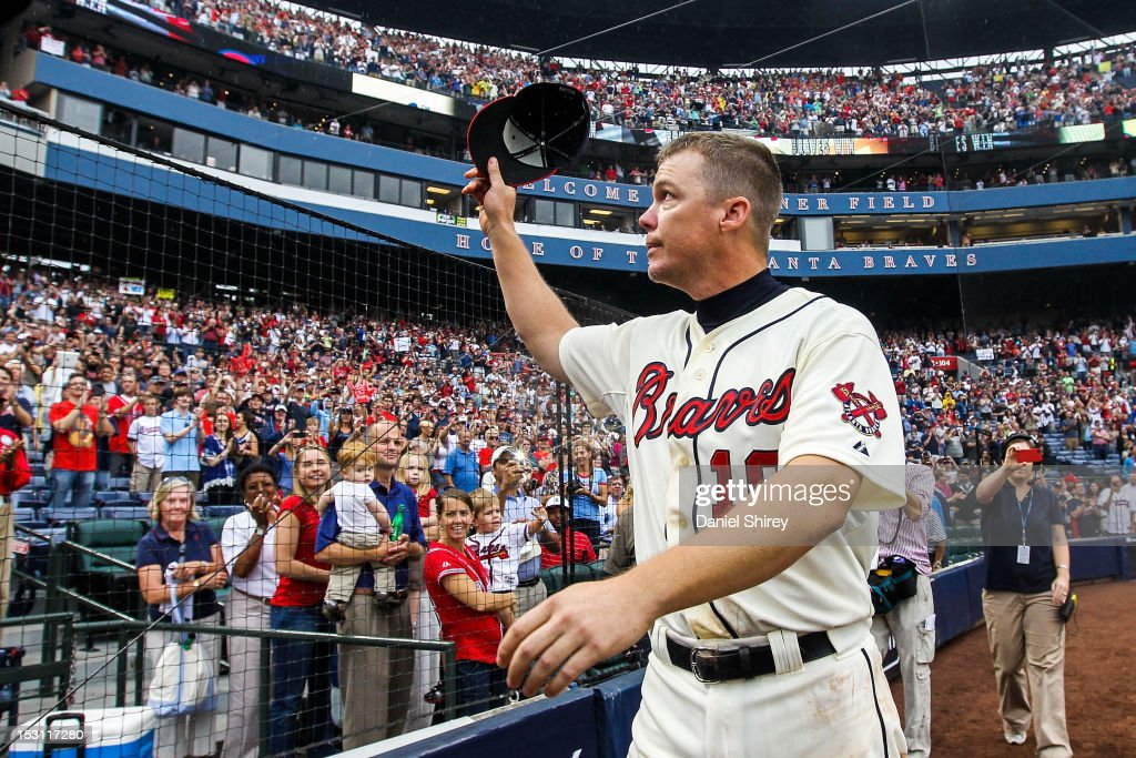 Chipper Jones of the Atlanta Braves waves his hat to fans after the game against the New York Mets at Turner Field on September 30 2012 in Atlanta...