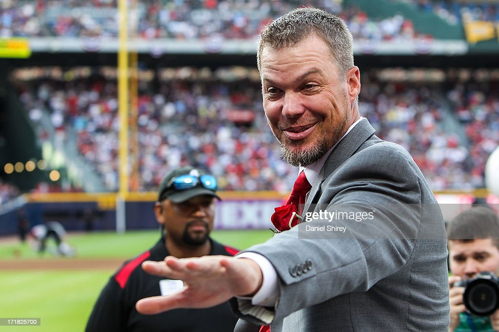 <a gi-track='captionPersonalityLinkClicked' href=/galleries/search?phrase=Chipper+Jones&family=editorial&specificpeople=171256 ng-click='$event.stopPropagation()'>Chipper Jones</a> #10 of the Atlanta Braves waves to fans during his number retirement ceremony before the game against the Arizona Diamondbacks at Turner Field on June 28, 2013 in Atlanta, Georgia.
