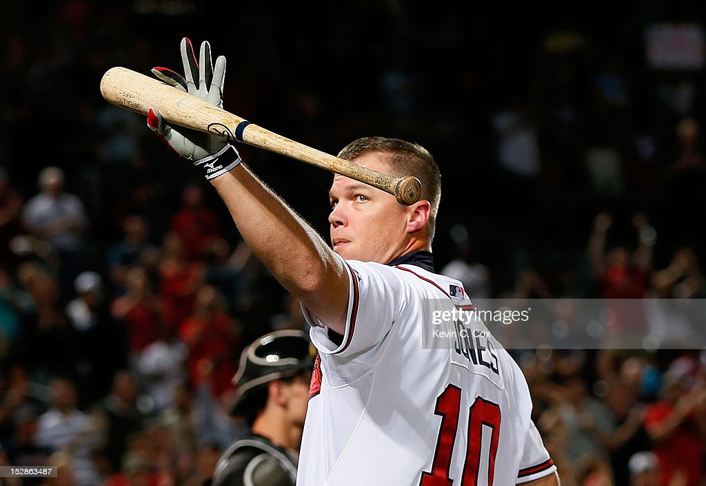 <a gi-track='captionPersonalityLinkClicked' href=/galleries/search?phrase=Chipper+Jones&family=editorial&specificpeople=171256 ng-click='$event.stopPropagation()'>Chipper Jones</a> #10 of the Atlanta Braves waves to the fans during a standing ovation as he stepped to the plate in the second inning against the Miami Marlins at Turner Field on September 27, 2012 in Atlanta, Georgia.