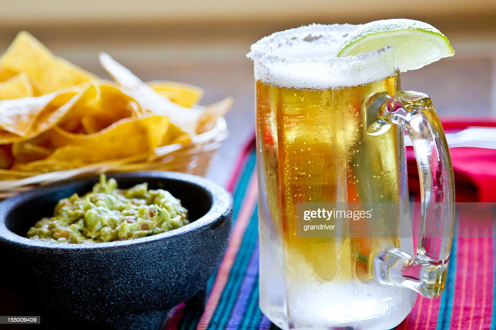 Chips, Beer and Guacamole : Stock Photo