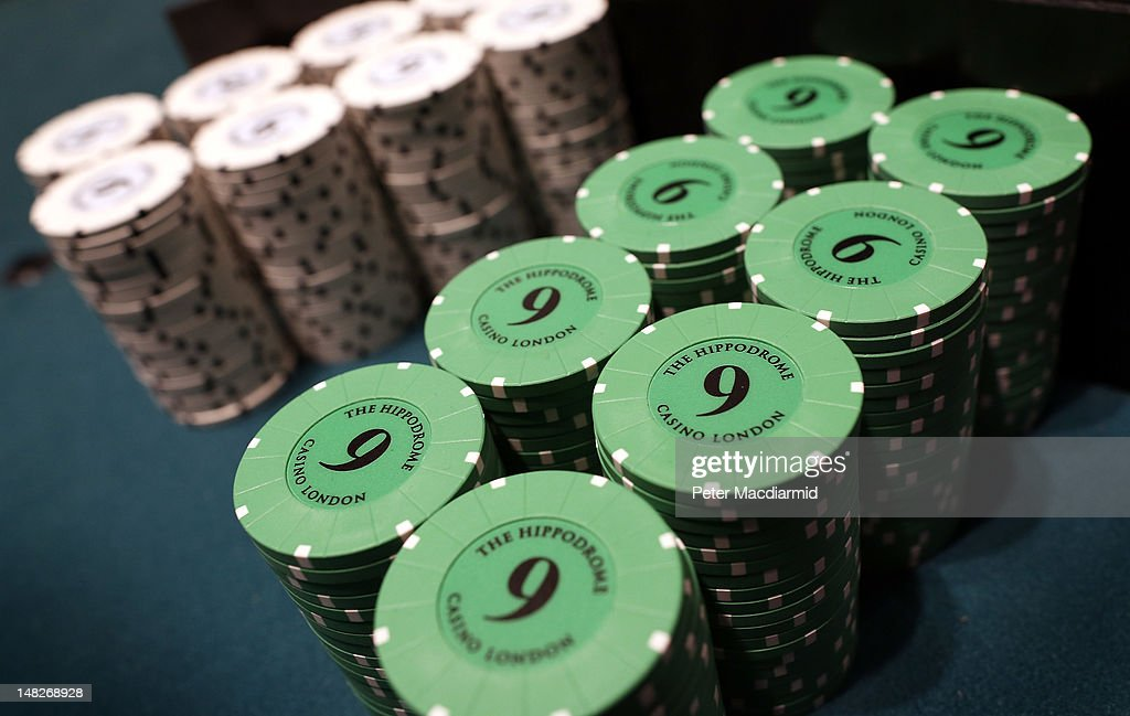 Chips pile up next to a roulette wheel at The Hippodrome Casino near Leicester Square on July 13, 2012 in London, England. The new casino has five floors and 90,000 square feet of slot machines, blackjack and roulette tables.