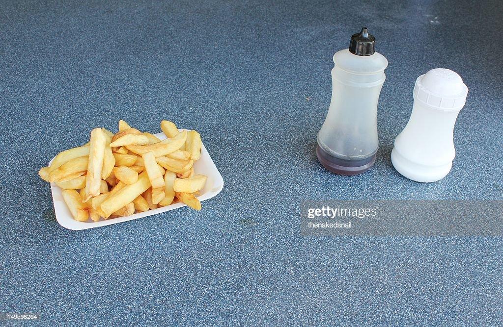 Chips, salt and vinegar. : Stock Photo