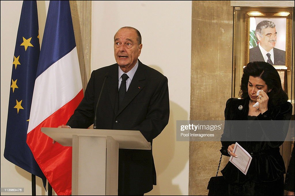 Hariri Murderers Will Not Escape Justice In Paris, France On February 04, 2006 -French President <a gi-track='captionPersonalityLinkClicked' href=/galleries/search?phrase=Jacques+Chirac&family=editorial&specificpeople=165237 ng-click='$event.stopPropagation()'>Jacques Chirac</a>, left, speaks at a ceremony following the striking of a commemorative medal honoring former Lebanese Prime Minister Rafik Hariri, while Rafik Harari widow, Nazek Hariri stands tearful, right, in front of the portrait of her husband, at the Hotel de la Monnaie, responsible for making official coins and medals, in Paris.