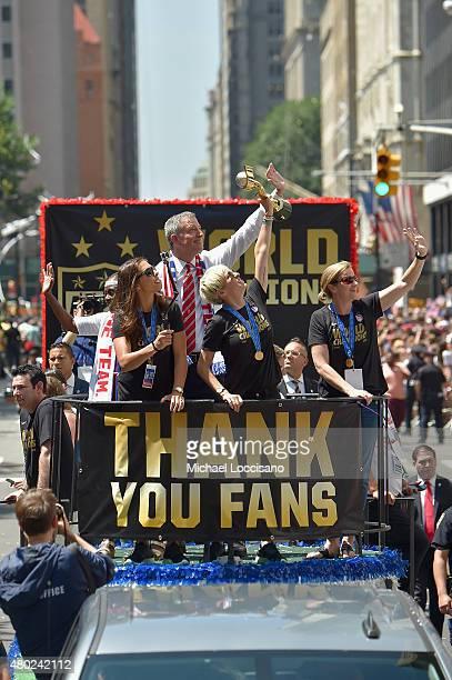 Chirlane McCray soccer player Carli Lloyd Mayor Bill de Blasio soccer player Megan Rapinoe and US Coach Jill Ellis aboard a float in the New York...