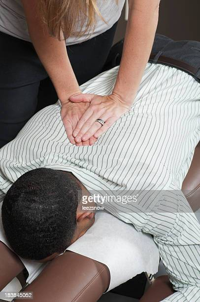 Chiropractor treating a patients back