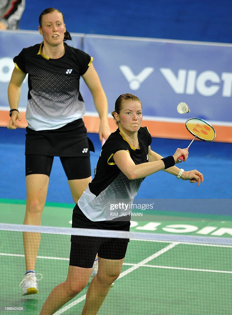 Chirstinna Pedersen (R) and Kamilla Rytter Juhi of Denmark play a shot during their women's doubles badminton match against Ma Jin and Tang Jinhua of China during the semi-finals of the Korea Open at Seoul on January 12, 2013. Ma Jin and Tang Jinhua won the match 21-19, 19-21, 21-11. AFP PHOTO / KIM JAE-HWAN