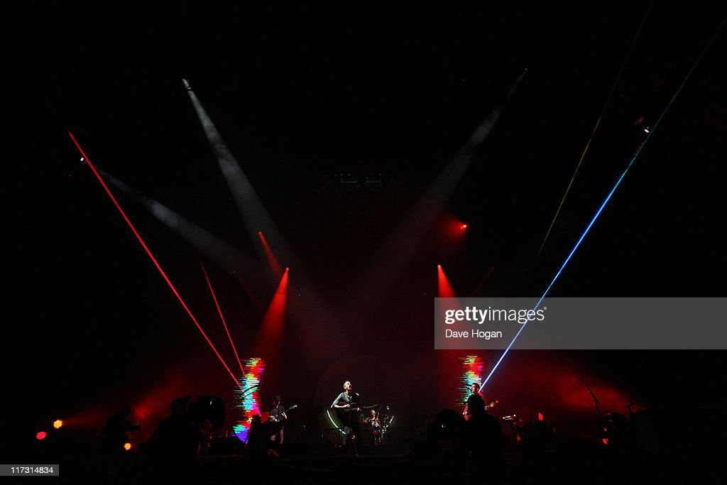 Chis Martin, Johnny Buckland, Will Chapion and Guy Berryman of Coldplay perform at the Glastonbury Festival at Worthy Farm, Pilton on June 25, 2011 in Glastonbury, England. The festival, which started in 1970 when several hundred hippies paid 1 GBP to watch Marc Bolan, has grown into Europe's largest music festival attracting more than 175,000 people over five days.