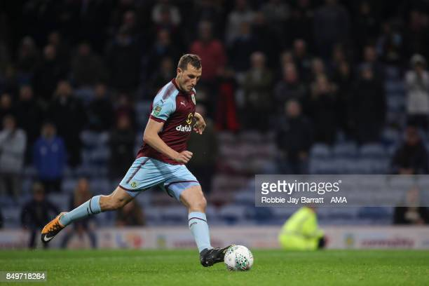 Chis Wood of Burnley scores his penalty during the Carabao Cup Third Round match between Burnley and Leeds United at Turf Moor on September 19 2017...