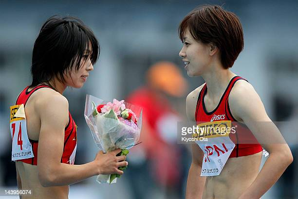 Chisato Fukushima and Kana Ichikawa of Japan celebrate after winning the Women's 4x100m Relay during the Seiko Golden Grand Prix Kawasaki at Todoroki...