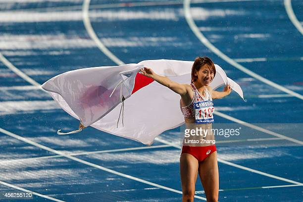 Chisato Fukushima of Japan celebrates winning the silver medal in the Women's 100m Final during day nine of the 2014 Asian Games at Incheon Asiad...