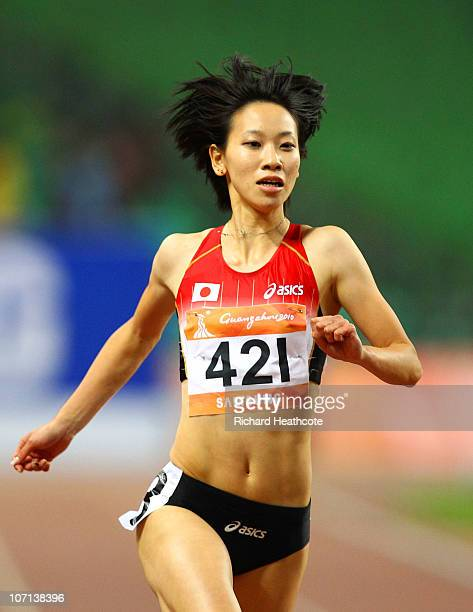 Chisato Fukushima of Japan competes in the women's 200m final at Aoti Main Stadium during day thirteen of the 16th Asian Games Guangzhou 2010 on...