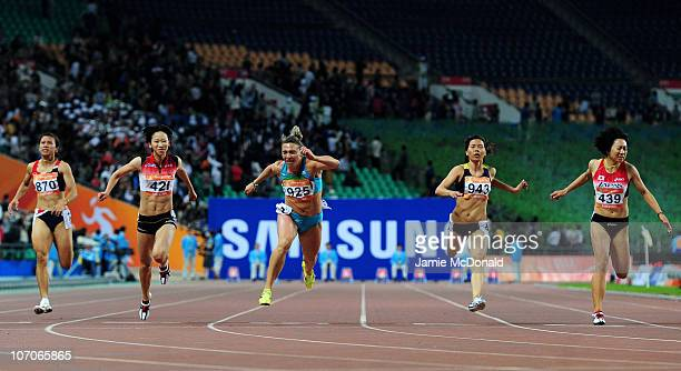 Chisato Fukushima of Japan crosses the line to win the gold medal in the Women's 100m Final at Aoti Main Stadium during day ten of the 16th Asian...