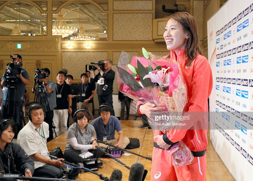 <a gi-track='captionPersonalityLinkClicked' href=/galleries/search?phrase=Chisato+Fukushima&family=editorial&specificpeople=2254354 ng-click='$event.stopPropagation()'>Chisato Fukushima</a> receives a flower bouquet from media reporters on her birthday during the Track and Field Japan Team for Rio de Janeiro Olympic Games press conference on June 27, 2016 in Tokyo, Japan.