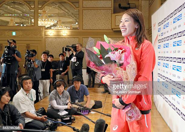 Chisato Fukushima receives a flower bouquet from media reporters on her birthday during the Track and Field Japan Team for Rio de Janeiro Olympic...