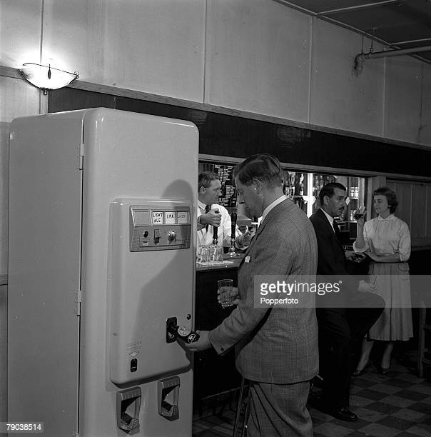 Chislehurst Kent England An automatic barmaid machine is pictured at the Tiger's Head public house as a customer purchases a bottle of beer
