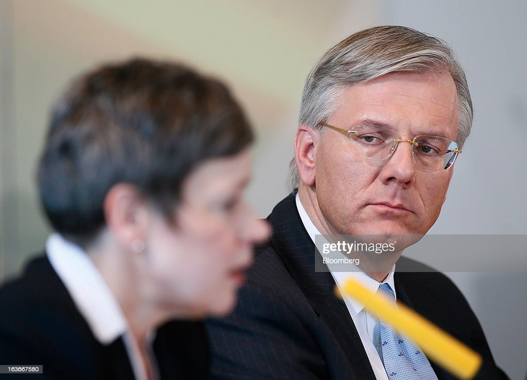 Chistoph Franz, chief executive officer of Deutsche Lufthansa AG, right, listens while Simone Menne, chief financial officer of Deutsche Lufthansa AG, left, speaks during a news conference to announce company results in Frankfurt, Germany, on Thursday, March 14, 2013. Deutsche Lufthansa AG agreed to renew its short-haul fleet with 100 mostly fuel-efficient jets from Airbus SAS, as the airline seeks to cut kerosene costs that constitute its single biggest expense. Photographer: Ralph Orlowski/Bloomberg via Getty Images