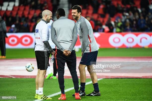 Chistophe Jallet of Lyon talks with Blaise Matuidi and Thiago Motta of PSG during the French Ligue 1 match between Paris Saint Germain and Lyon at...