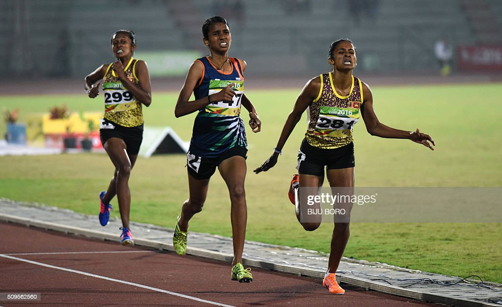 Chithra PU (C) of India along with other competitors take part in the women's 1500m event during the 12th South Asian Games 2016 at Indira Gandhi Athletics Stadium in Guwahati on February 11, 2016. AFP PHOTO/ Biju BORO / AFP / BIJU BORO