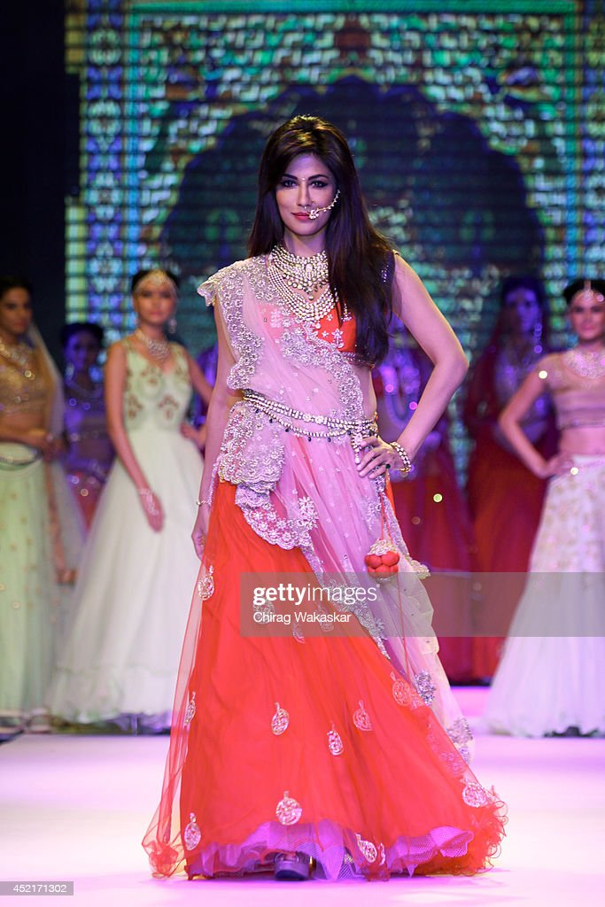 Chitrangada Singh walks the runway at the Moni Agarwal show during day 1 of the India International Jewellery Week 2014 at grand Hyatt on July 14, 2014 in Mumbai, India.