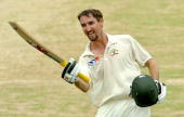 Australian cricketer Jason Gillespie gestures as he celebrates scoring a century during the third day of the second Test match between Bangladesh and...