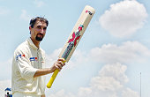Australian cricketer Jason Gillespie raises his bat in celebration of his double century during the fourth day of the second Test match between...