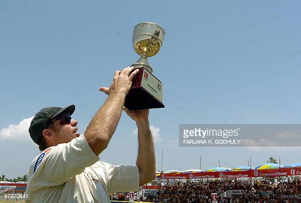 Australian cricketer Matthew Haydan afloats their winning trophy at the end of the second Test match between Bangladesh and Australia at the...