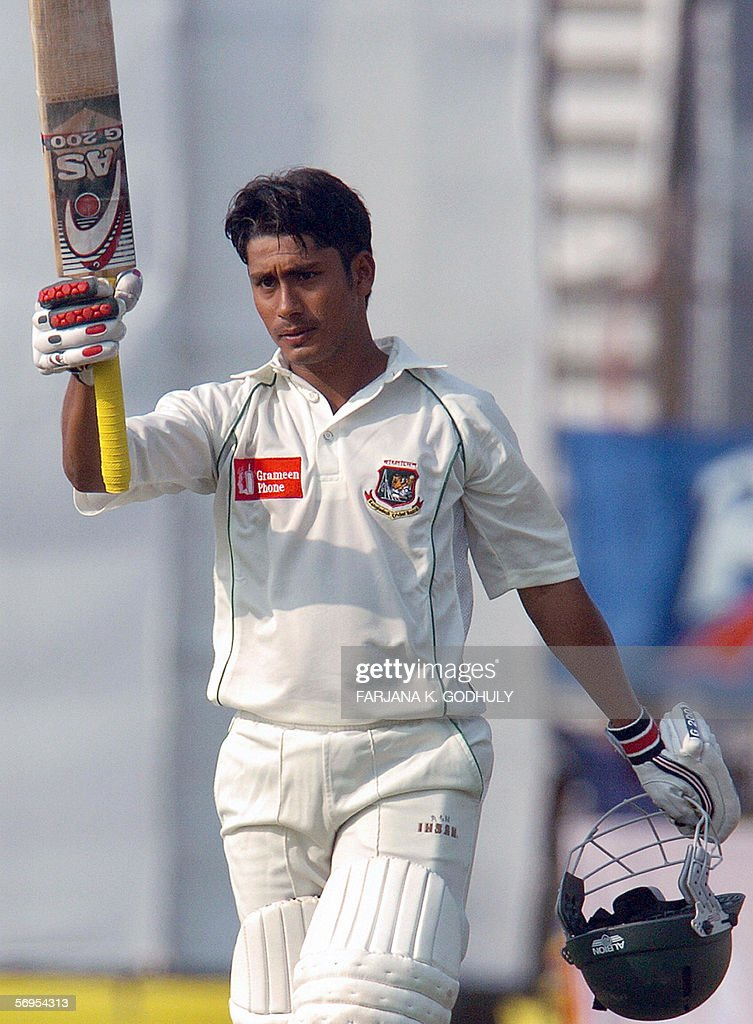 Bangladeshi batsman Mohammad Ashraful raises his bat after he scored a century during the first day of the first Test match between Bangladesh and...