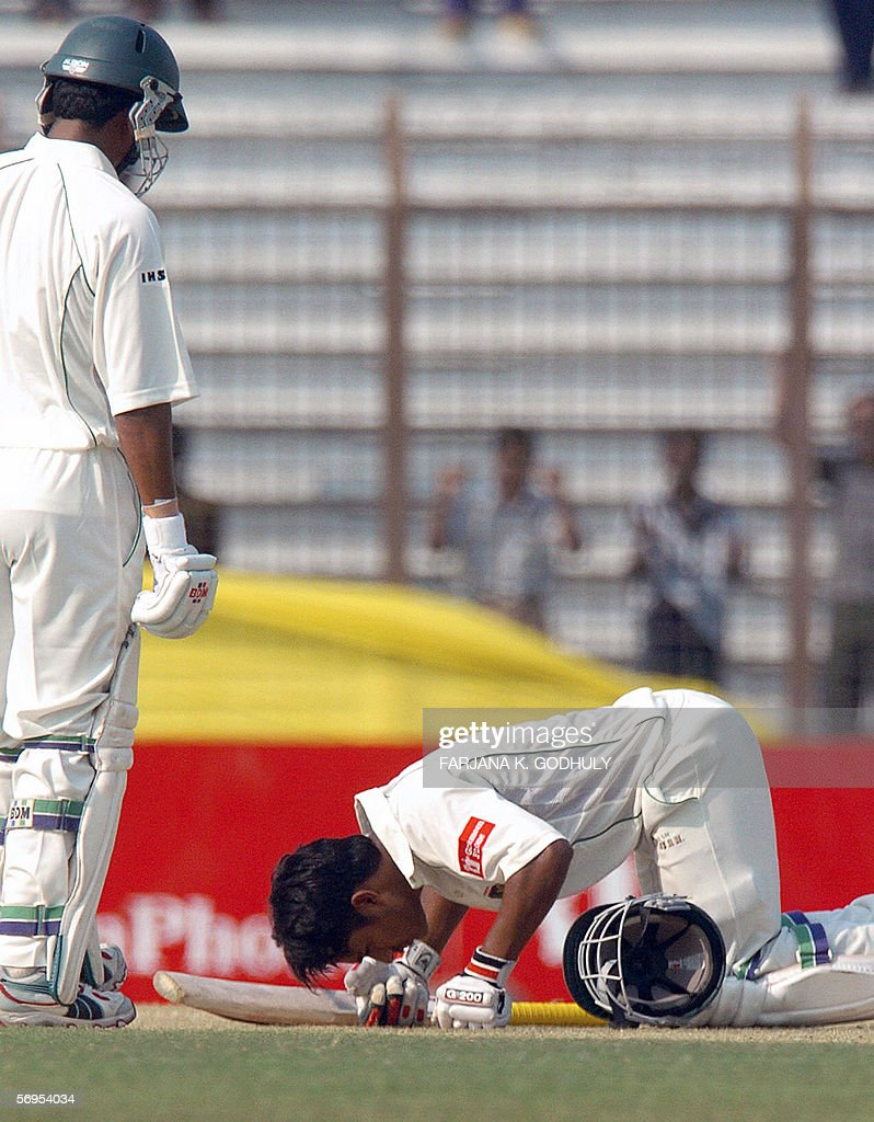 Bangladeshi batsman Mohammad Ashraful touches the ground after he scored a century as his teammate Alok Kapali looks on during the first day of the...