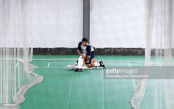 Indian cricketer Sachin Tendulkar pads up during an indoor session of net practice for the Indian Test squad at the Ruhul Amin Cricket Stadium in...